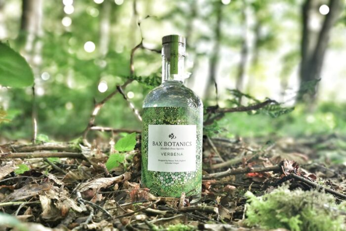 Verbena alcohol free spirit bottle. healthy natural backdrop