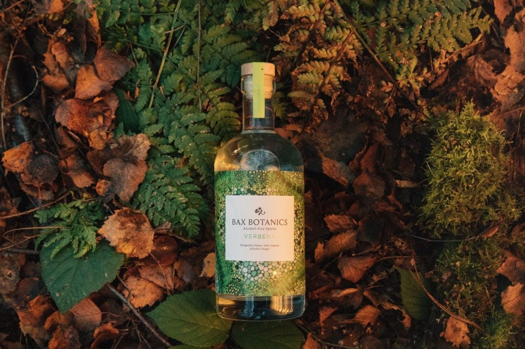 Bax Botanics. Alcohol free spirit. Bottle in leaf litter