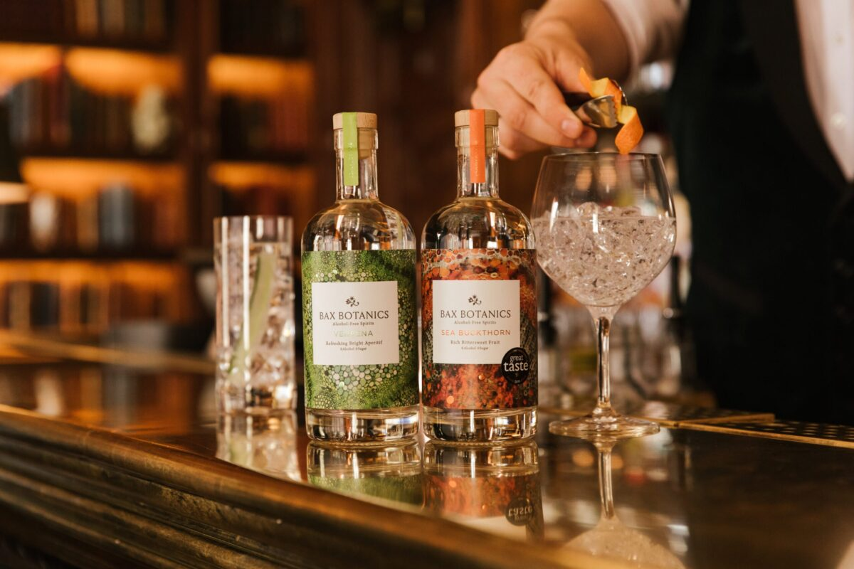 A bottle of each flavour on posh bar with a cocktail.