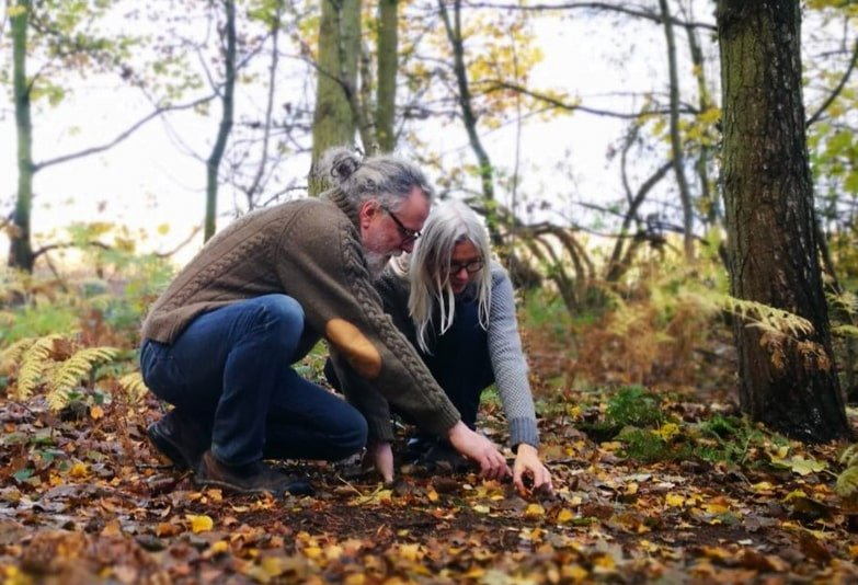 Chris and Rose Bax. Alcohol free spirit distillers outdoors, foraging in their natural woodland
